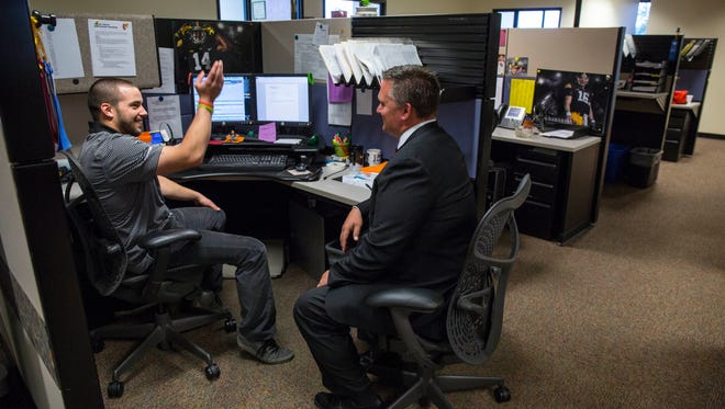 IMT Group Iowa's Top Workplaces, 4445 Corporate Drive, West Des Moines - Sean Kennedy, CEO of IMT Group, right, with employee David Puffett, left, Tuesday Aug 23, 2016.