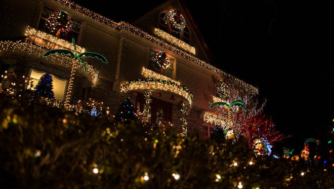 One Bay Ridge house hosts multiple themes with palm trees, a nativity scene, the word 'JOY' and more in the yard.