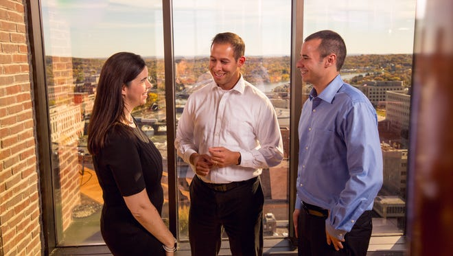 At Davie Kaplan CPA offices in downtown Rochester: Jennifer Jones, left, audit/accounting partner; Brian Sauers, audit/accounting partner; Anthony Cicotta, audit/accounting manager.