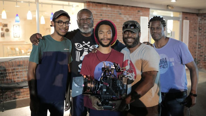 "The Mackson family of filmmakers once again has shot a gritty short dramatic film in their hometown of Plainfield. ""Heroin(e)"" is a soon-to-be-released follow-up to last year's award-winning ""Moves We Make."" From left: Co-director/Editor Isaiah Mackson, 20, Co-director Patrick Coker, Director of Photography Kalani Mackson, 23, Executive Producer Lamar Mackson and Producer Kenny C. Williams."