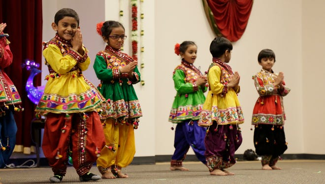 Young dancers at the Gujarati Samaj Hindu temple on Apalachee Parkway last year's Diwali celebration, the Hindu New Year festival. This year, the temple celebrated it's 10th year of rebirth after it was destroyed by fire.
