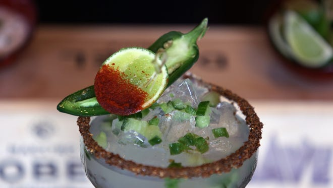 The chili cucumber margarita ($13) at Agave in North Naples includes spicy agave loco pepper-cured tequila, Thatcher's cucumber liqueur, fresh jalapeño and cucumber, citrus and a spicy chili pepper.