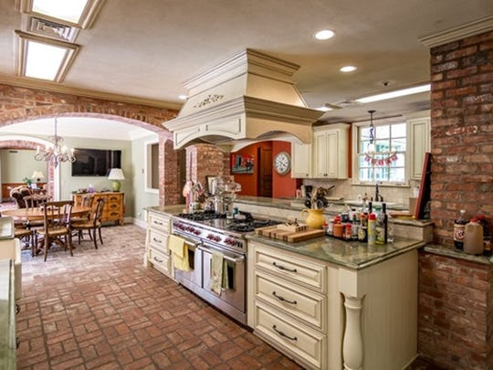 The kitchen at 7030 East Ridge Drive features a massive island complete with stove and plenty of prep room.