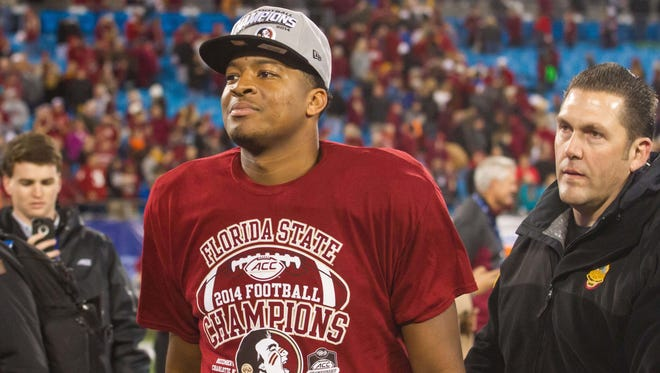 Dec 6, 2014; Charlotte, NC, USA; Florida State Seminoles quarterback Jameis Winston (5) walks off the field after defeating the Georgia Tech Yellow Jackets at Bank of America Stadium. FSU defeated Georgia Tech 37-35. Mandatory Credit: Jeremy Brevard-USA TODAY Sports