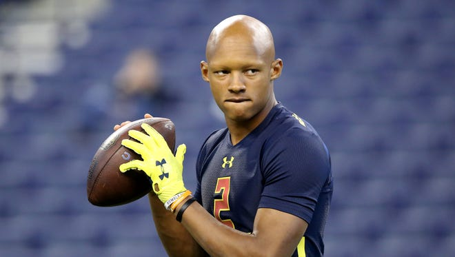 Tennessee quarterback Josh Dobbs is seen in a drill at the 2017 NFL football scouting combine Saturday, March 4, 2017, in Indianapolis.