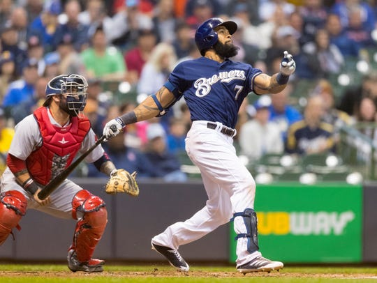 Eric Thames checks out his home run in the first inning.