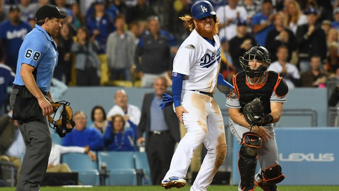 Justin Turner reacts after sufferering a right hamstring injury against the Miami Marlins.