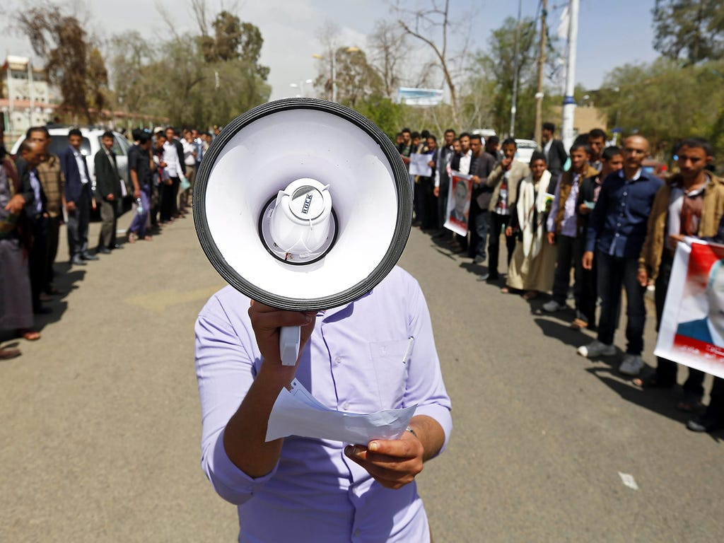 A university student shouts slogans during a rally against recent suicide attacks on March 22 in Sanaa, Yemen.