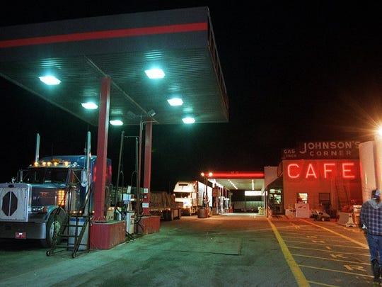A lone truck driver walks toward Johnson's Corner Cafe.