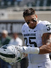 AP Michigan State linebacker Joe Bachie shakes off