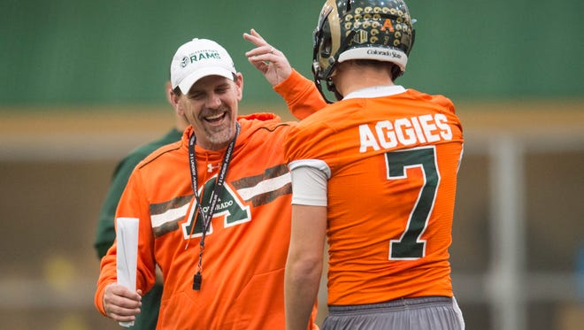 CSU coach Mike Bobo congratulates quarterback Nick Stevens during a practice last spring. Bobo said the Rams need players, rather than coaches, to be the leaders this fall.