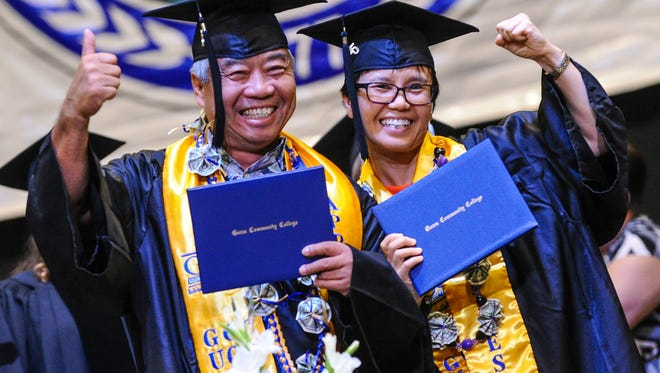 Euro Car Service co-workers Cy Leung, left, and Yukyu Lee express their joy after receiving their certificates during the Guam Community College's 38th commencement exercise at the University of Guam Calvo Field House in Mangilao on May 19.
