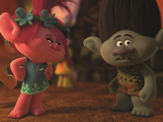 """Perky Poppy (voice of Anna Kendrick) cajoles the cranky Branch (voice of Justin Timberlake) into finding his inner troll in """"Trolls."""""""