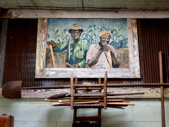 A painting representing rural life in the South inside Big Mama's Antiques & Restorations.