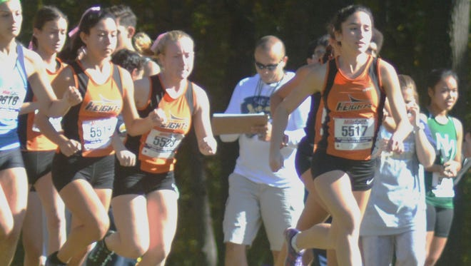 Hasbrouck Heights senior Giana DiLascio (right) won the Group D individual title at Bergen County Championships.