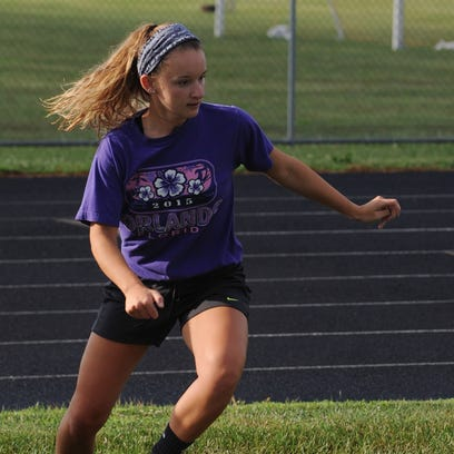 Tylar Reno, senior at Piketon High School, runs through a dribbling drill during soccer camp Tuesday at Piketon High School. Piketon will have a girls only soccer team this year.