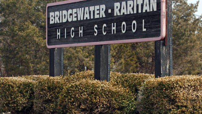 The state commissioner of education has ruled that Bridgewater-Raritan must pay $127,000 in back salary to a teacher in a tenure dispute.