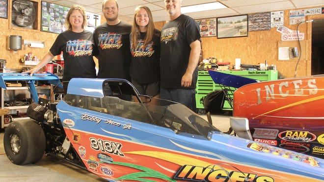 The Ince family -- Mary, Bobby Jr., Hannah, and Bobby Sr. -- stand beside the junior dragster that is now being raced by Hannah and beside the tail of a Chevelle that Bobby Jr. runs.