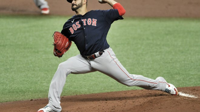 Boston Red Sox starter Martin Perez pitches against the Tampa Bay Rays during the first inning of a baseball game Sunday in St. Petersburg, Fla.