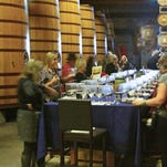 A group takes part in a wine tasting at Dry Creek Vineyards in Sonoma. Dry Creek has been making wine since 1972.