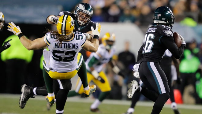 Philadelphia Eagle Allen Barbre puts a big hit on Green Bay Packers' Clay Matthews as Bryce Treggs runs for yardage.