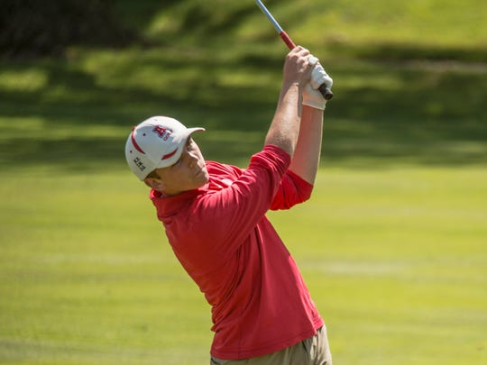 Matthew Raab of Arrowhead observes his shot during the Homestead Sectional golf tournament in Mequon on May 30.
