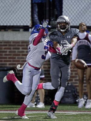 Alma's Tykee Ogle-Kellogg can't make the catch as he's defended by Red Bank's Zay Brown during their game Thursday, Oct. 20, 2016.