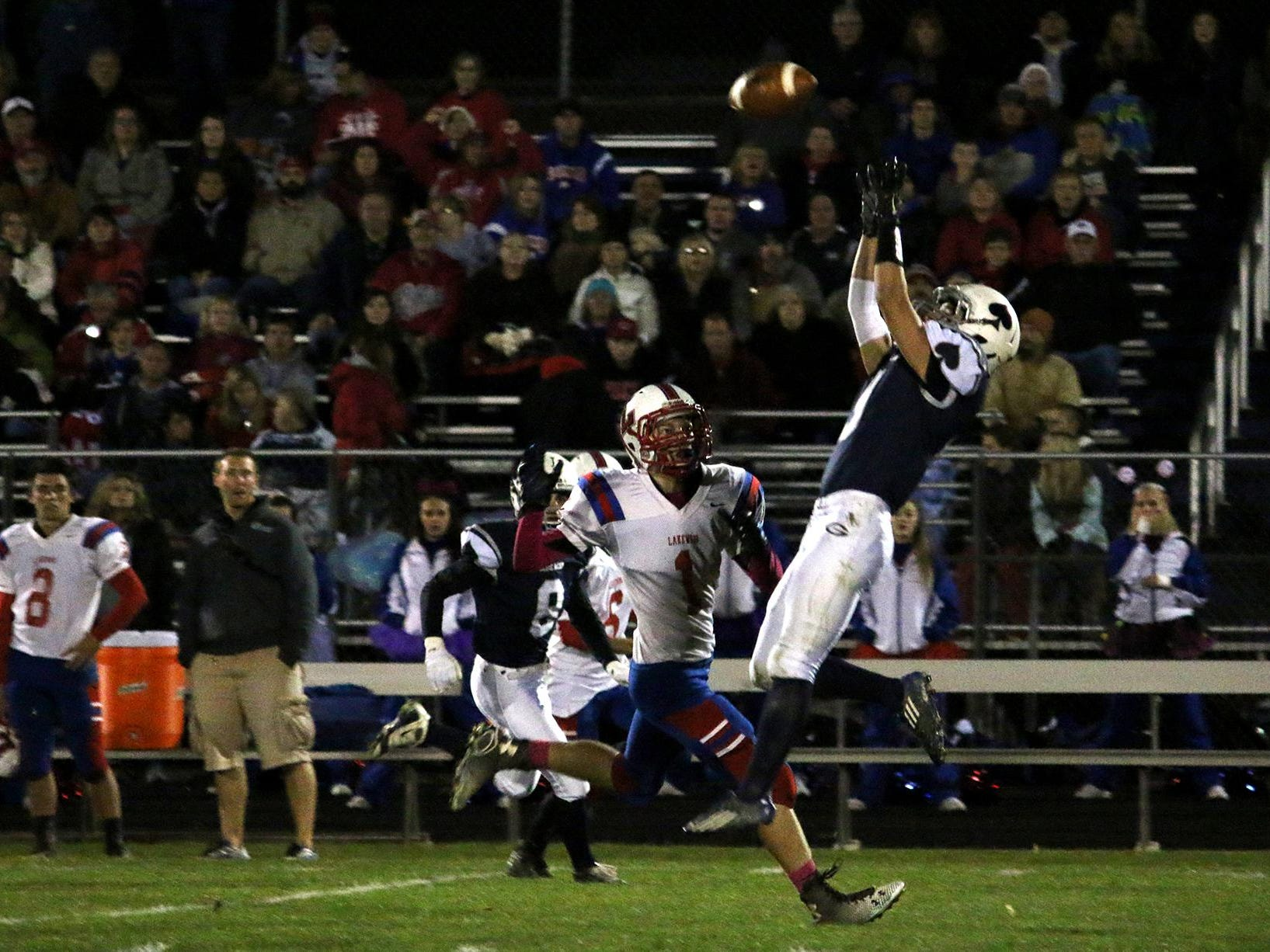 GranvilleÕs Hunter Brown leaps up for the ball. The Blue Aces defeated the Lancers 63-7 on Friday Oct. 30, 2015.