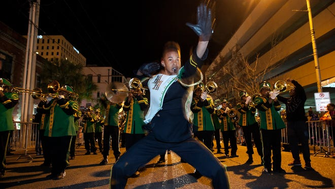 Trevon Ceasar leads the Washington Marion High School band down East Vermilion Street downtown during the Queen Evangeline Parade  on Lundi Gras.  John Rowland/Special to the Advertiser