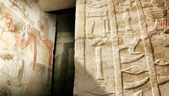 FILE PICTURE - Hieroglyphic details including eye and tusk symbols representing the dentistry profession, below-right, on the entrance to 4,200-year-old tombs honoring a chief dentist, pictured on wall at left, and two other dentists who served the nobility of the 5th dynasty, at the Saqarra pyramid complex south of Cairo, Egypt Sunday, Oct. 22, 2006.