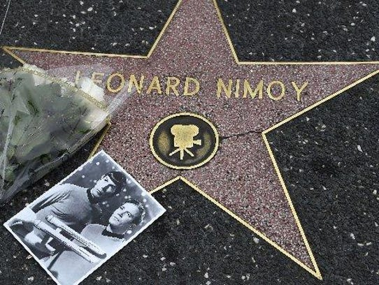 Flowers are placed on the star of actor Leonard Nimoy,
