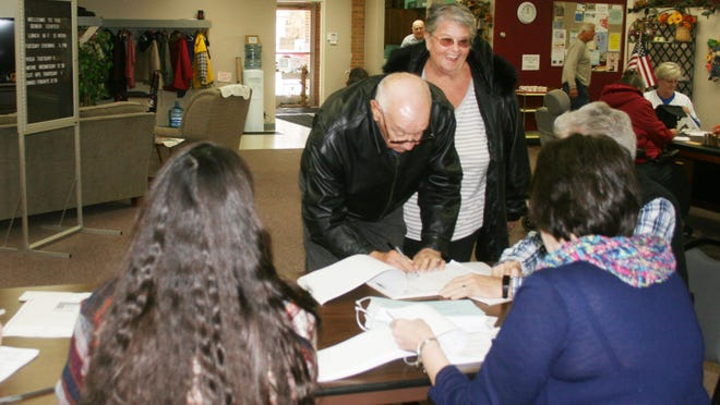 Voters check in with poll workers at the Kewanee Senior Center on South Street during a recent local election.