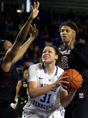 MTSU's TiAnna Porter goes up for a shot between multiple