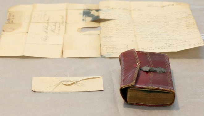 A photo of George Washington's hair and the almanac it was found in at Union College in New York.