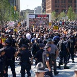 Police and protesters in Cleveland on July 19, 2016.