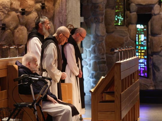 The monks at the Abbey of the Genesee pray in their recently renovated chapel.
