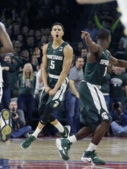 Michigan State guard Bryn Forbes celebrates a 3-point