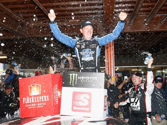 Clint Bowyer celebrates after winning at Michigan International Speedway last June.