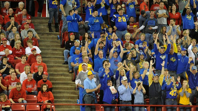 SDSU fans cheer for the Jackrabbits during a football game Saturday at the DakotaDome in Vermillion. The Jacks won 30-23 in front of the sold-out crowd.
