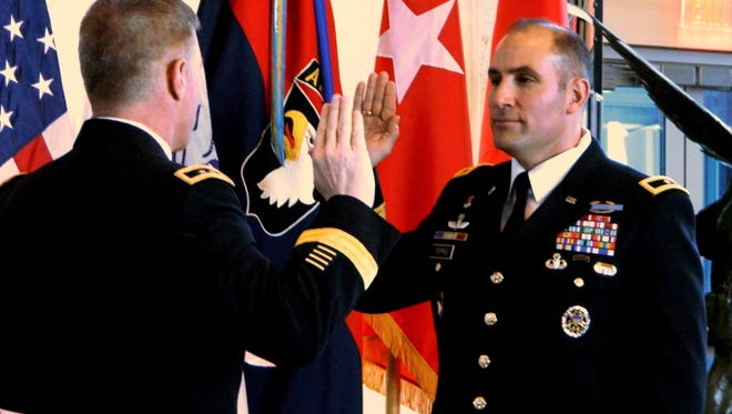 Then Brig. Gen. Andrew Poppas, right, recites the oath of a general, administered by 101st Airborne Division commander Maj. Gen. James C. McConville in February 2013 at Fort Campbell. Poppas will take over as Fort Campbell's next commanding general.