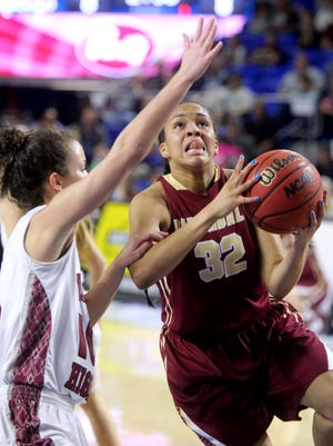 Riverdale's Brinae Alexander (32) goes up for a shot as she is guarded by Morristown West's Blayke Shultz (10) during the State Tournament quarterfinals last season.