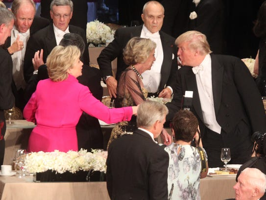 Hillary Clinton and Donald Trump attend the Alfred