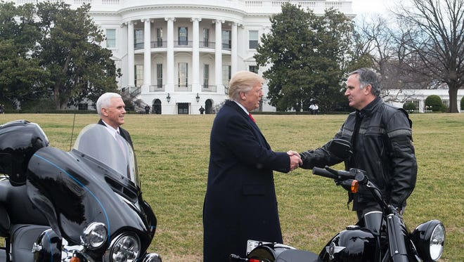 President Donald Trump greets Harley-Davidson CEO Matthew Levatich as he arrives with Vice President Mike Pence to meet with Harley executives and union representatives on the South Lawn of the White House on Feb. 2.