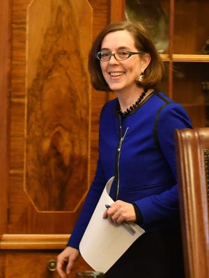 Gov. Kate Brown makes an entrance during a press conference on Friday, Feb. 20, 2015, at the Oregon State Capitol in Salem, Ore.