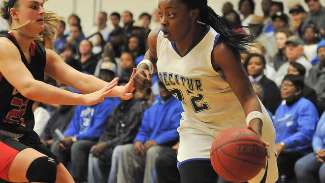 Stephen Decatur guard Dayona Godwin drives against a Glenelg defender on Saturday in the 3A region finals.