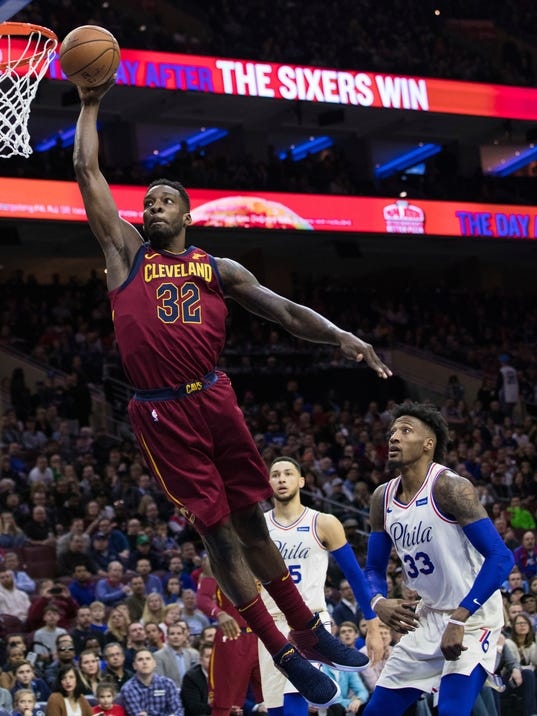 Cleveland Cavaliers' Jeff Green, left, goes up to shoot as he gets past Philadelphia 76ers' Robert Covington, right, during the first half of an NBA basketball game, Friday, April 6, 2018, in Philadelphia. (AP Photo/Chris Szagola)