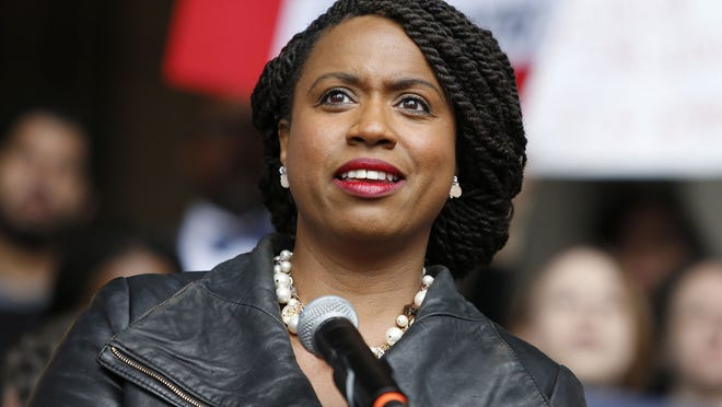 In this Oct. 1, 2018 file photo, Boston City Councilor Ayanna Pressley speaks at a rally at City Hall in Boston. On Nov. 6, 2018, Pressley became Massachusetts' first black woman elected to the U.S. House of Representatives.