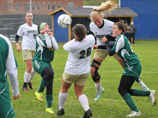 Meg Macfarlane heads in the winning goal with 6.7 seconds to go in the second overtime as Essex edged BFA-St. Albans 2-1 in high school girls soccer Saturday.
