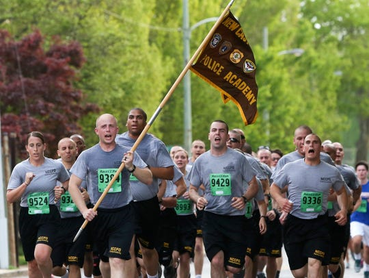 New Castle County police recruits run together during the Szczerba Memorial 5k in April 2017.