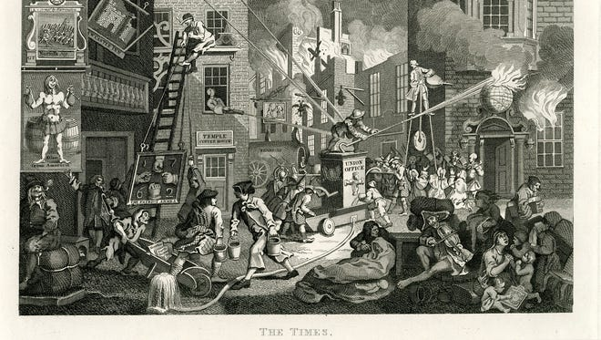"""British Prime Minister William Pitt is depicted as fanning the flames of war -- in the guise of a building on fire -- in """"The Times."""""""